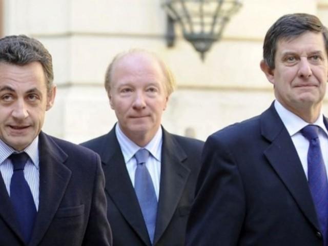 Nicolas Sarkozy et Jean-Pierre Jouyet accompagnés de Brice Hortefeux
